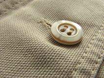 Denim fragment. Denim clothes fragment with a button Stock Photo