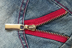 Denim fragment with pink zipper Stock Images
