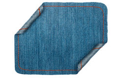 Denim frame folded in the form of manuscripts, on a white background Stock Images