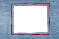 Denim frame with light jeans with red rhinestones Stock Images