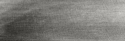 Denim-Gewebe-Schwarz-Beschaffenheit Indigo-Jeans-Samt-Hintergrund Stockfotos
