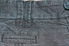 Denim Grungy in un quadrato con i bottoni Jeans grigio scuro d'annata, buoni per fondo Fotografie Stock Libere da Diritti