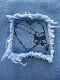 Denim Heart 3. A denim square patch containing a heart with a blank banner across it Royalty Free Stock Photos