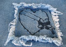Denim Heart. A denim patch containing a heart with a blank banner across it Royalty Free Stock Photos