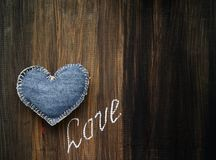 Denim heart and the inscription LOVE Stock Photos