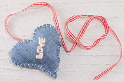 Denim heart with the word love on it Royalty Free Stock Image