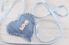 Denim heart with the word love on it Royalty Free Stock Images