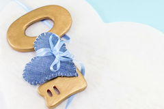 Denim heart wrapped around a big wooden key Royalty Free Stock Images