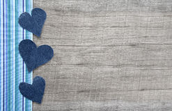 Denim hearts on grey shabby chic wooden background royalty free stock photo