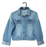 Denim jacket. On a hanger. Isolated on white. Clipping path included Royalty Free Stock Photos