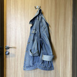 Denim jacket hanging on a hook Royalty Free Stock Photo