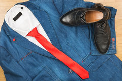 Denim jacket and red tie and classic black shoes, men`s fashion. Stock Photography