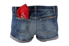 Denim Jean Shorts. Worn denim shorts with red bandana in back pocket isolated on white background royalty free stock photography