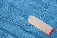 JEANS texture background with tag. Denim jeans background with seam of jeans fashion design and tag Royalty Free Stock Images