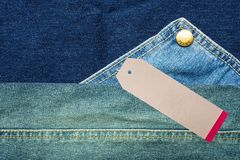 JEANS texture background with tag. Denim jeans background with seam of jeans fashion design and tag Stock Photo