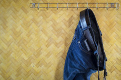 Denim Jeans and Belt hanging Royalty Free Stock Images