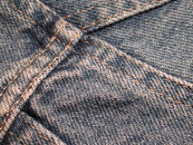 Denim Jeans Fabric Texture. A macro shot of denim jeans with seam and thread good as a background, layer or texture stock images