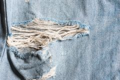 Denim jeans fabric texture background with old jeans Stock Photo
