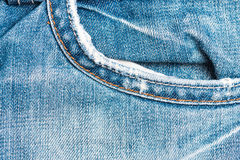 Denim jeans fabric texture background with old jeans Royalty Free Stock Photography