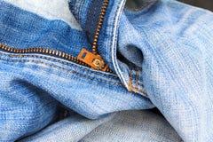 Denim jeans fabric texture or denim jeans background with locking brass zipper. Denim jeans fabric texture or denim jeans background with locking brass zipper Stock Image