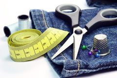 Denim jeans and sewing utensils Royalty Free Stock Image