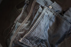 Denim jeans soak in water, simply wash or clean jeans in dim lig Stock Photos