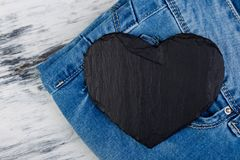 Denim. Jeans texture background. Valentine Day. Black Stone Slate heart. Copy space Royalty Free Stock Images