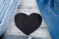 Denim. Jeans texture background. Valentine Day. Black Stone Slate heart. Copy space Stock Images