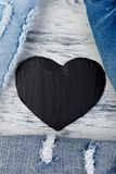 Denim. Jeans texture background. Valentine Day. Black Stone Slate heart. Copy space Stock Photos