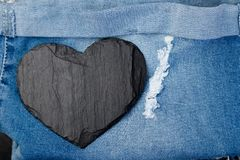 Denim. Jeans texture background. Valentine Day. Black Stone Slate heart. Copy space. Denim. Jeans texture background. Valentine Day. Black Stone Slate heart Stock Photos