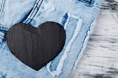 Denim. Jeans texture background. Valentine Day. Black Stone Slate heart. Copy space Stock Photography