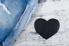Denim. Jeans texture background. Valentine Day. Black Stone Slate heart. Copy space Royalty Free Stock Image