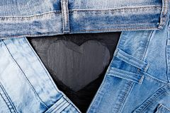 Denim. Jeans texture background. Valentine Day. Black Stone Slate heart. Copy space. Denim. Jeans texture background. Valentine Day. Black Stone Slate heart Royalty Free Stock Photography