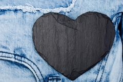Denim. Jeans texture background. Valentine Day. Black Stone Slate heart. Copy space. Denim. Jeans texture background. Valentine Day. Black Stone Slate heart Stock Image