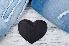 Denim. Jeans texture background. Valentine Day. Black Stone Slate heart. Copy space Stock Photo