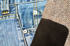 Denim jeans and tweed jacket Stock Images
