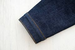 Denim jeans on wooden royalty free stock photography