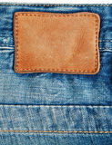 Denim with label. Close-up blue denim with label Stock Photography