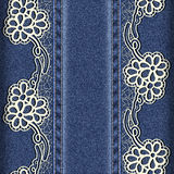 Denim and lace. Background with lace ribbons sewn vertically. Royalty Free Stock Photo