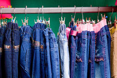 Denim pants on a hanger for children in the store Royalty Free Stock Photos