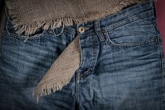 Denim pants are on old linen burlap abstract background royalty free stock images