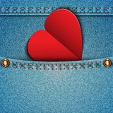 Denim pocket with an attached heart. Royalty Free Stock Photo