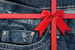 Denim Pocket Closeup with Red Bow. Royalty Free Stock Photography