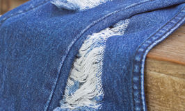 Denim Rip Background. Texture in the Fabric Stock Image