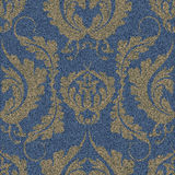 Denim seamless pattern with a gold Damascus print. Blue background with a large floral ornament. Stock Photography