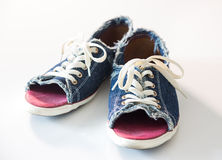 Denim shoes on white background Stock Photos
