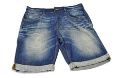 Denim shorts. A pair of denim shorts on a white background Stock Photography