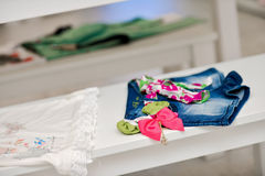 Denim shorts for children and white blouse Royalty Free Stock Image