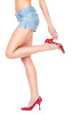 Denim skirt and sexy legs Stock Images