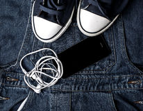 Denim sneakers and gadgets Stock Image